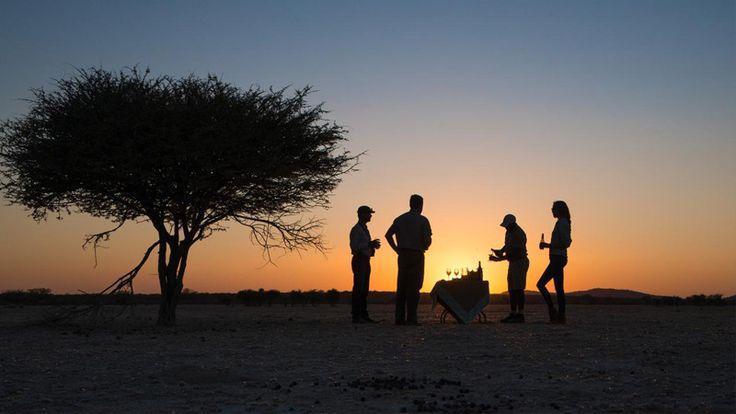 Enjoy sundowners in the desert at Ongava Lodge, Etosha National Park #luxurytravel #namibia