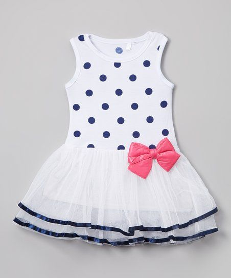 Gossamer skirt tiers and perky polka dots sweeten this sleeveless dress. A colorful bow finishes the look, and stretch-blend cotton provides a comfy touch.