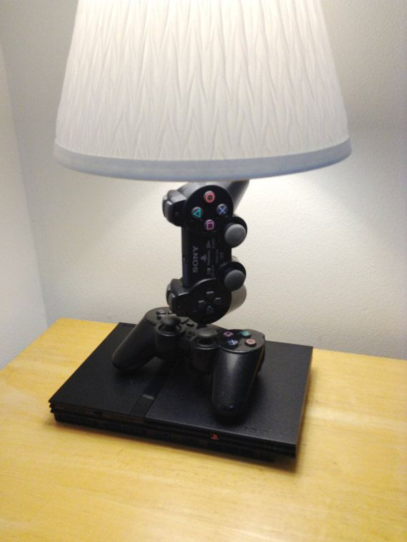 Slim, Simple, and Sleek.  This is a very unique lamp sculpture I made using a PlayStation 2 console and 2 controllers. The system and the