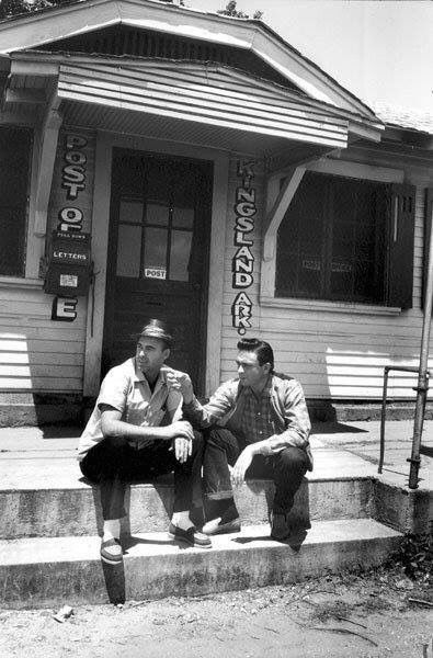 Johnny Horton and Johnny Cash Johnny Horton  hang out on the steps of the post office in Kingsland, Arkansas.