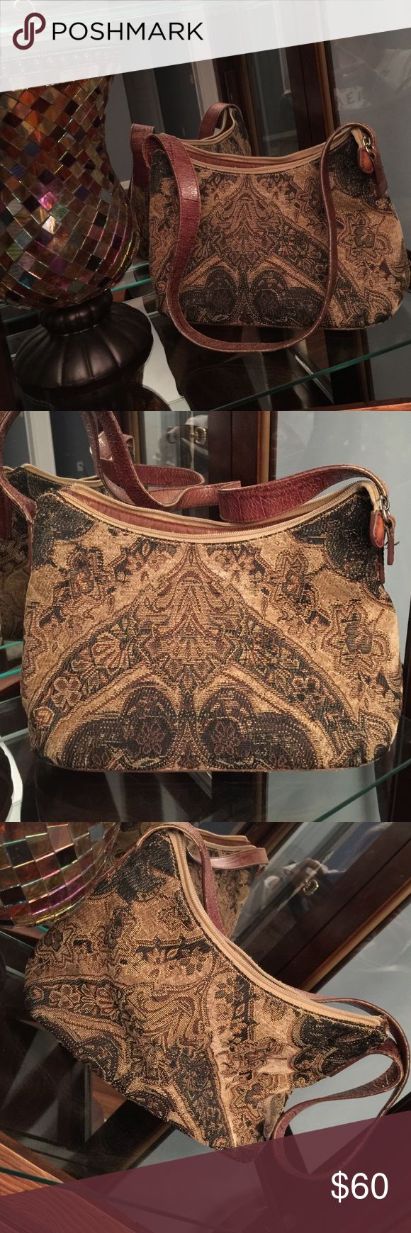 Vintage Fossil shoulder Bag This is truly THE MOST beautiful Fossil Bag I've EVER SEEN!❤️. Every stitch is designed to perfection! This has been so well taken care of💞. Must see and Feel to appreciate🎀. Only stain is on inside shown in last picture. Rustic colors Fossil Bags