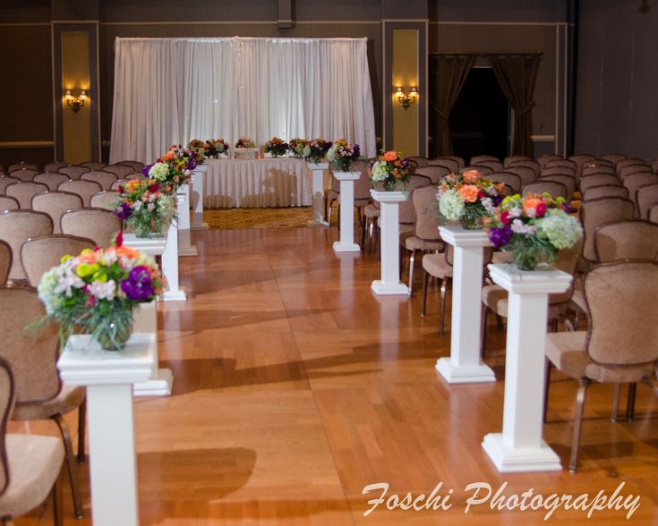 A great way of decorating your aisle is to use the table centerpieces like we did for Kate and Chris at Harry's Savoy Ballroom.