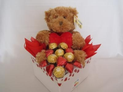 Valentine's Hamper that includes a super cute Marley bear and a selection of delicious chocolates including Fererro Rocher and milk chocolate hearts. All finished in a cute box with love.