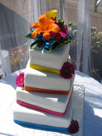 i like the offset stacking and the alternating color striped ribbons. I don't like the flowers.