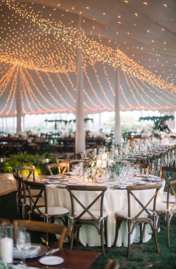 Gorgeous string light tent decor: http://www.stylemepretty.com/pennsylvania-weddings/pittsburgh/2015/12/22/rustic-elegant-fall-wedding/   Photography: Tim Will - http://www.timwill.com/