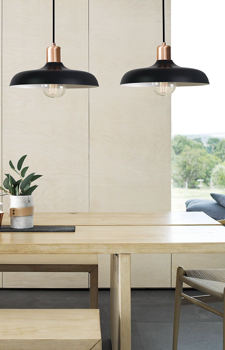 The Beacon Lighting Croft 1 light metal pendant in black with brushed copper detail.