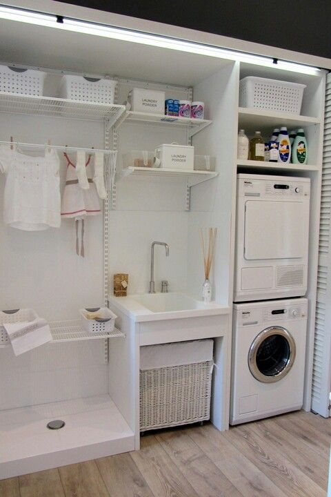 # Organized laundry area. A place for everything - best layout I've seen so far! I can picture a mudroom type bench with hooks and shelves on the opposite wall.