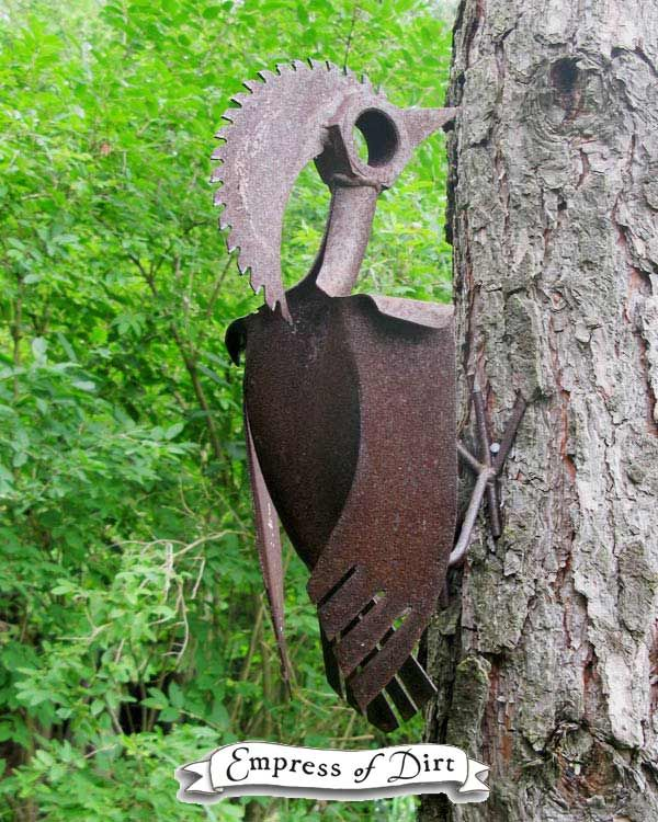 Love this garden art woodpecker made from old metal parts and tools.