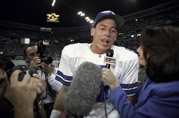 Dallas quarterback Troy Aikman #8 ♥♥♥ is interviewed by an ESPN sideline reporter after the Dallas Cowboys victory over the Green Bay Packers in the NFC Championship game on Jan. 14, 1996