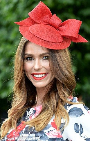 Pretty: A racegoer shows off a chic crimson hat that matches her red lipstick...