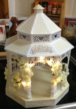 Cutting craftorium band stand made from ivory and cream centura pearl with minature rose buds. for Mr Mrs J Allan 50th Wedding Anniversary
