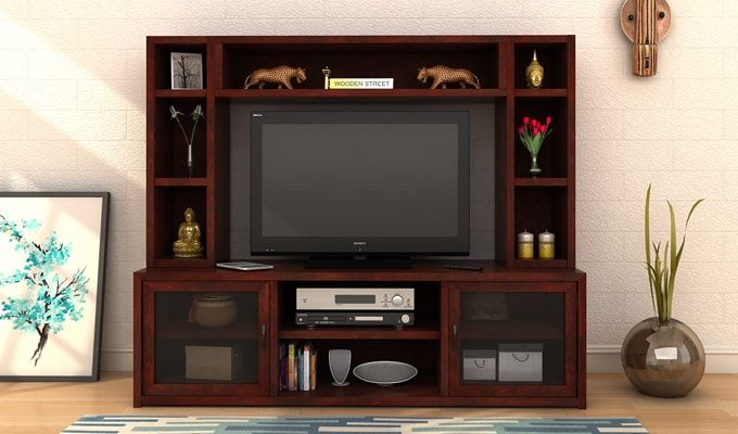 This amazing #TV #unit will not only prove to be a safe #house for your TV but will also help you keep your living room more organised. There are enough shelves and cabinets to store your treasuries. You can also use these shelves to place some decorative items to enhance the #beauty of your #room. #Furniture #India