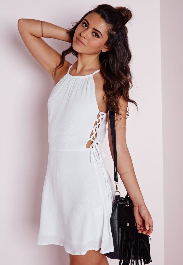 $50, White Skater Dress: Missguided Lace Up Side Skater Dress White. Sold by Missguided. Click for more info: https://lookastic.com/women/shop_items/301713/redirect