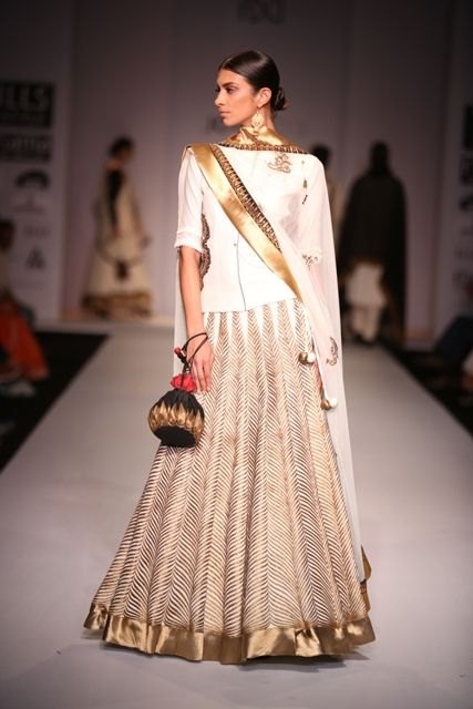 A gorgeous gold and white piece by Joy Mitra #wifw #ss14 #fdci #infashion #fashion #trends #fashionweek #joymitra