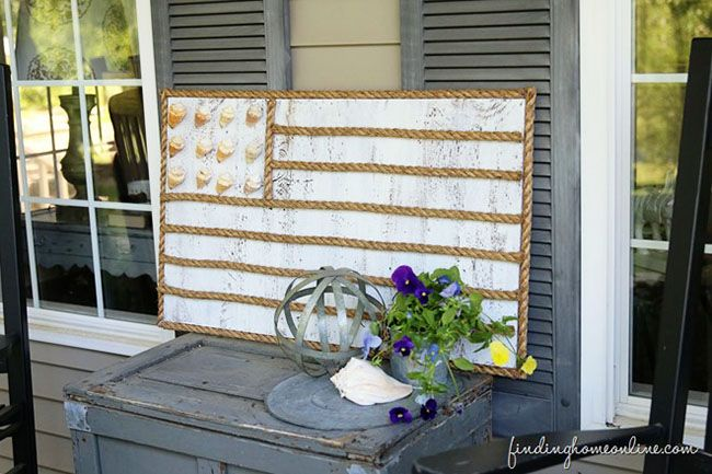 Bring a little bit of the beach right to your front porch.  DIY Rope and Shell Beach Flag from FindingHomeOnline.com tutorial at TidyMom.net...