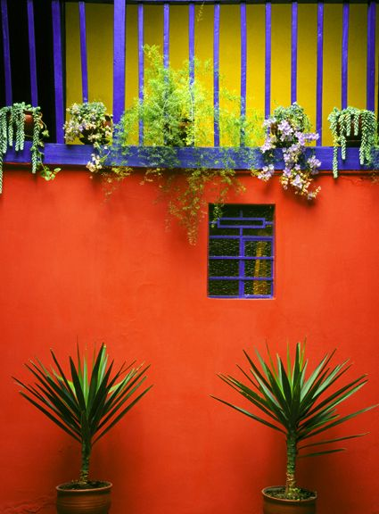Triadic Colors: The exterior of the house is an example of a triadic color scheme since the colors, purple, orange, and green are represented on the exterior. The three colors are equally spaced on the color wheel, meaning they are triadic.