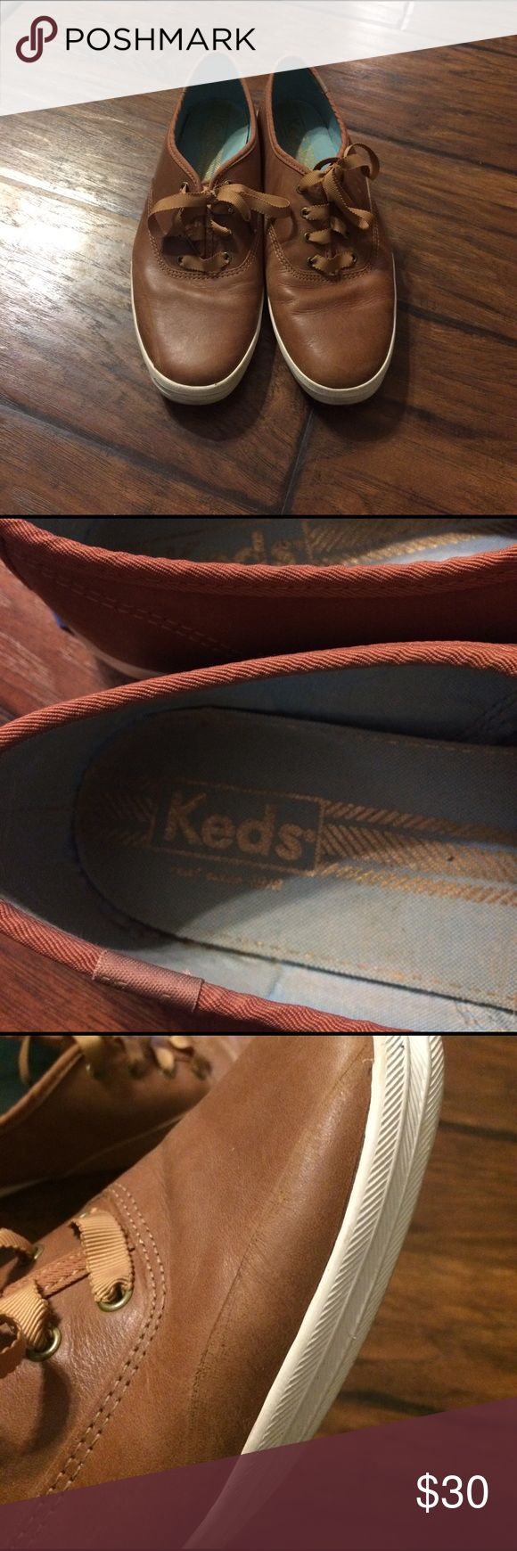 Leather Keds Cognac colored leather Keds with grosgrain ribbon laces. There is a visible scratch on the right foot, see pic, but could be much less obvious with polish. Keds Shoes Sneakers
