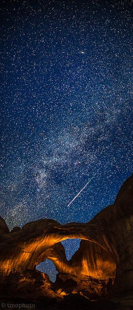 Perseid meteor streaking over the lightpainted double arch in Arches National Park. by tmo-photo on Flickr.