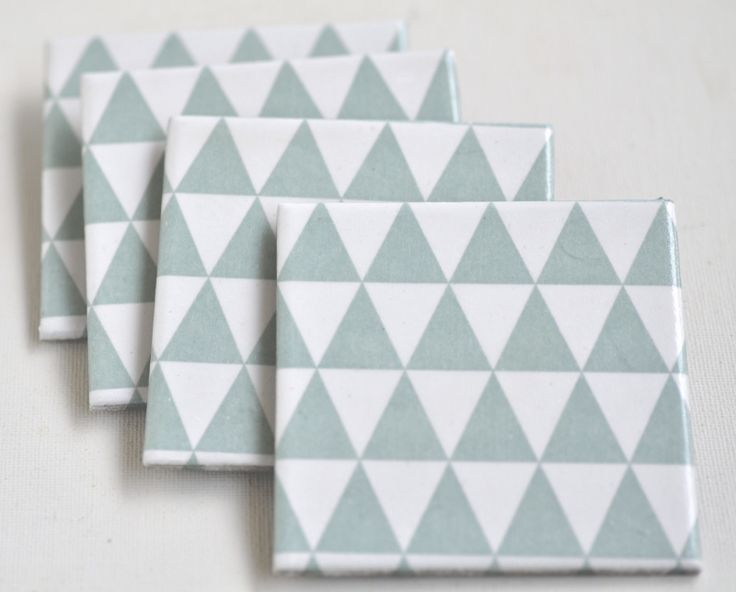These Mint Triangles Ceramic Coasters have a beautifully smooth, slightly glossy surface. They are heat and water resistant, and can be washed easily with a wet sponge. By Tilissimo.