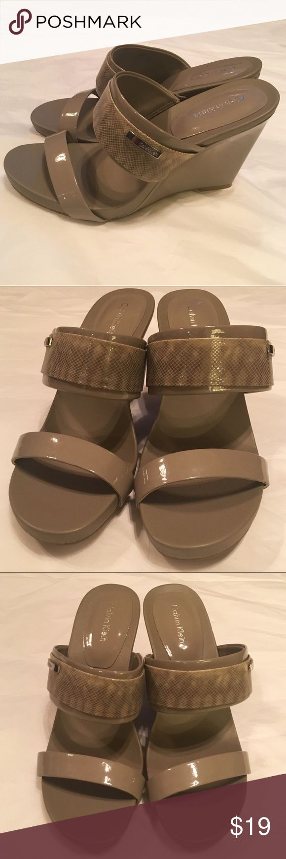 """Calvin Klein """"Omira"""" Patent Leather Wedges """"Beige"""" Neutral wedges that go with just about everything! There is a black scuff mark with some white around it that can be seen in pic. The shoes have elastic on the second straps. I don't believe it's stretched out at all but it can be seen it pics. It has a edgy python emboss and heel height is approx. 4in. The rubber outsole offers some extra traction and long wear. Calvin Klein Shoes Wedges"""