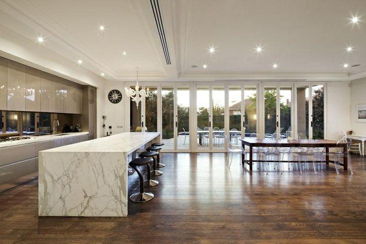 Calcutta Marble kitchen bench top. Spacious kitchen / dining area. Wooden floorboards :-))