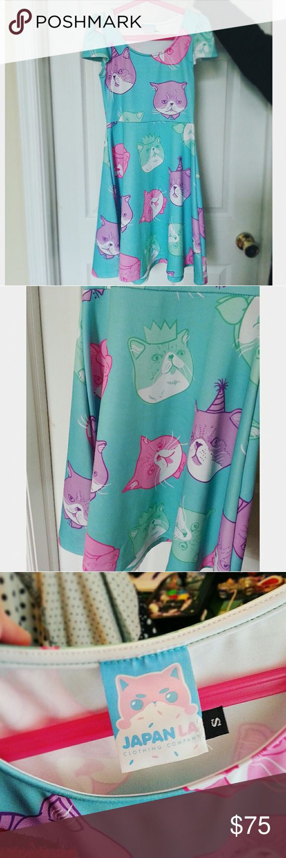 Japan LA Dapper Cat Dress Dolls Kill Kawaii XS S Super cute Japan LA dress that I bought about 4 years ago  In great condition as I only wore it a few times  5th pic shows these lines that were on it when I first bought it, how noticeable they are in the pic is how noticeable they are in real life which is not noticeable really!  Let me know if you have any questions!   Definitely fits a size smaller than marked which is why I listed it as an XS Dolls Kill Dresses Mini