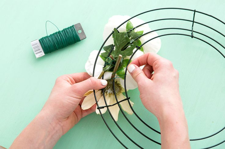 Using floral wire, weave a variety of silk flowers into a frame as the base for a beautiful spring wreath. #partner