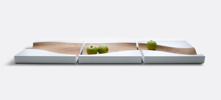 The Vloed (Studio Segers): a wooden fruit tray shaped like a river. It's channel seamlessly meanders through three square sections, which allow one to divide the tray throughout the house or to separate kinds of fruit within the same display. Altogether, the Vloed serves as a minimalist yet dynamic table piece, flowing naturalism and movement into one's dining area.
