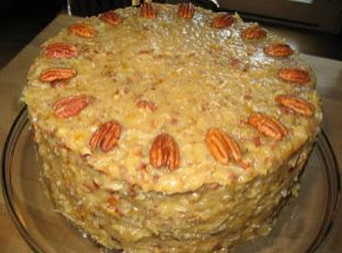 1/2 cup boiling water   4 ounces sweet cooking German chocolate   2 cups sugar   1 cup butter, softened   4 egg yolks   1 teasp...