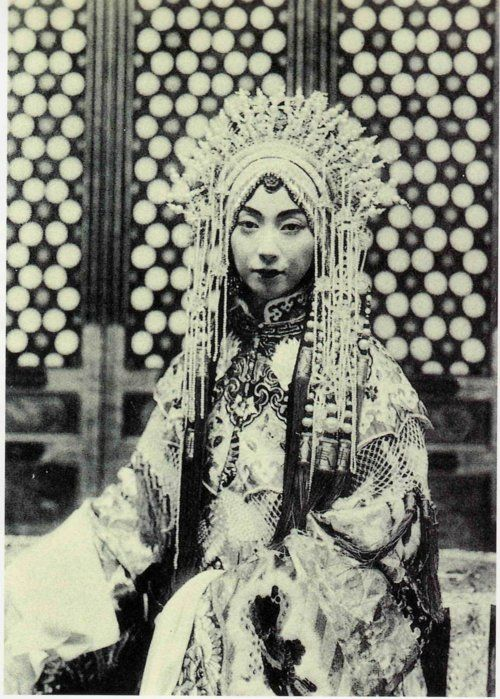 Mei Lanfang (1894-1961), male actor in the stage dress of a young woman - the only role he played in the Beijing Opera (also known as the Peking Opera or Jingju Opera). He introduced Beijing Opera to the World with his tours to Japan in 1919 and 1924, to the U.S. in 1930, and the USSR in 1932 and 1935. more via chineseopera