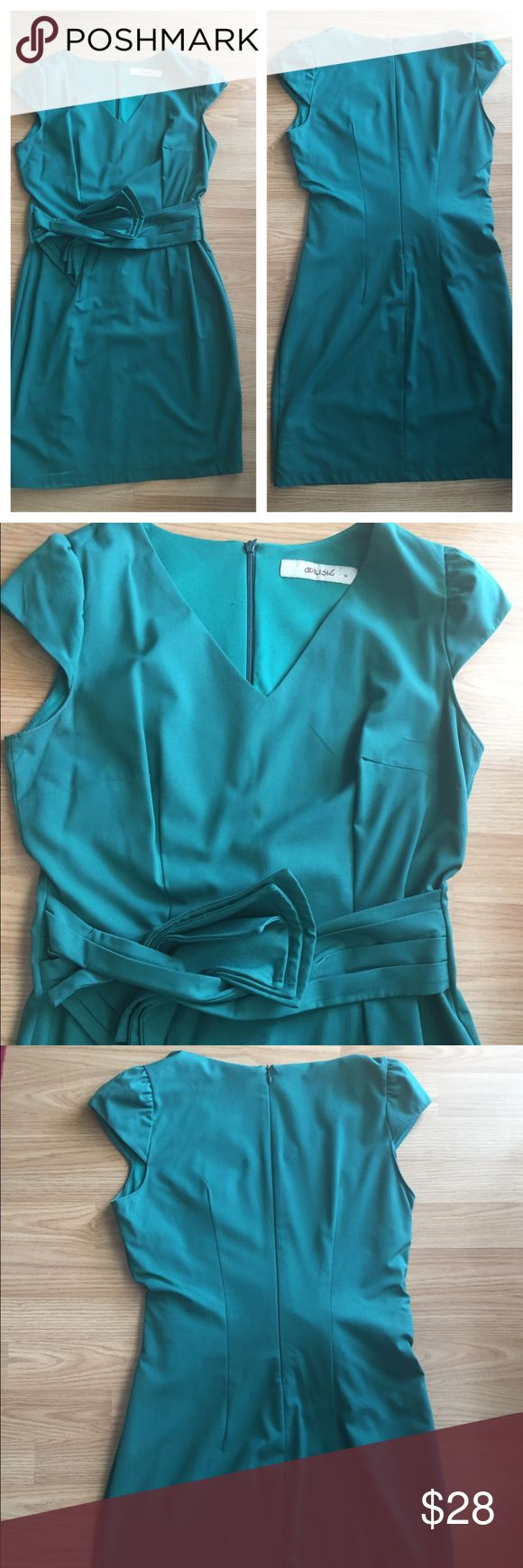 Gorgeous green mini dress Super beautiful green mini dress. V neck, short sleeve. Worn twice. Dresses Mini