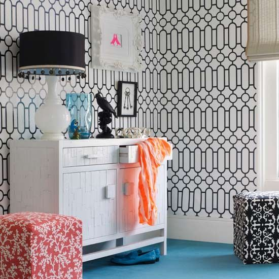 Graphic print wallpaper and sophisticated storage  The key to a girl's room? Storage, storage, storage. A multi-functional freestanding console, with drawers, cupboards and a good-height countertop is a great starting point for giving order to the growing volume of clothes and make-up. Box stools can double up as clutter-hiding storage, too.