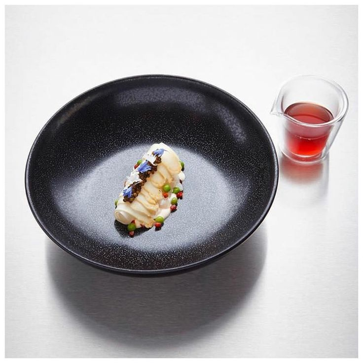 Squid, Imperial Caviar & White Asparagus by @thomasbuehner of 3 Michelin starred La Vie in Germany. Dish shot by @helgekirchbergerphotography during Che Bühner's residency at Ikarus Restaurant in Salzburg, Austria. #food #foodie #foodart #foodporn #fourmagazine