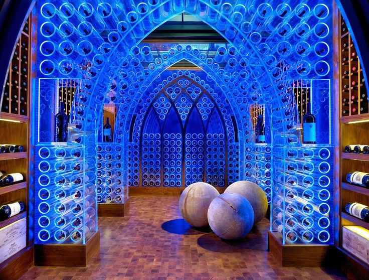How to Design your wine storage & display in home ? * * *  Clear, acrylic Gothic-style arches fill the wine cellar and provide space for approximately 2,000 bottles of red, white, rose and champagne. The arches are lit by color-changing LED lights, which can be turned off when entertaining wraps up. And if the temperature controlled wine storage isn't suitable, there's a tasting area just outside of the cellar where guests can enjoy their beverages.