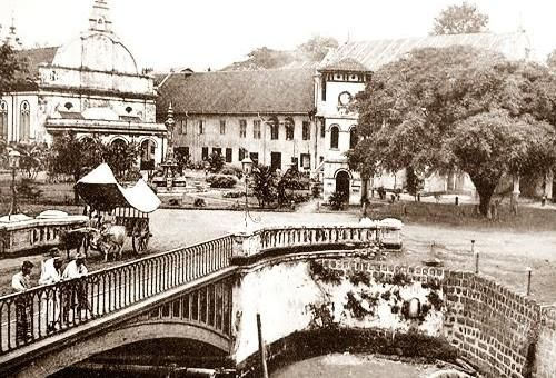 Old Malacca. you can see the Stadhuy, Clock Tower, Victoria Fountain and also a wagon in the photo.