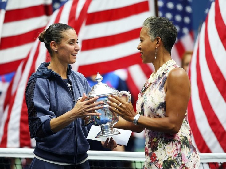 9/12/15 US Open 2015 Champion Flavia Pennetta Saves Her Best for Last Then Retires On-Court - USTA President Katrina Adams presents her with the Winner's Trophy in Arthur Ashe Stadium.