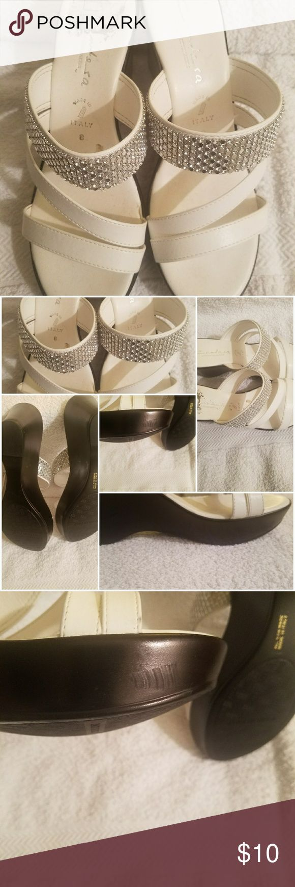 White wedge sandals Black and white wedge sandals with a bit of bling. Made for summer and for spring. Or, for just about anything. They have been worn and do have a scuff as shown. Very comfortable. (corny, I know). Shoes Sandals