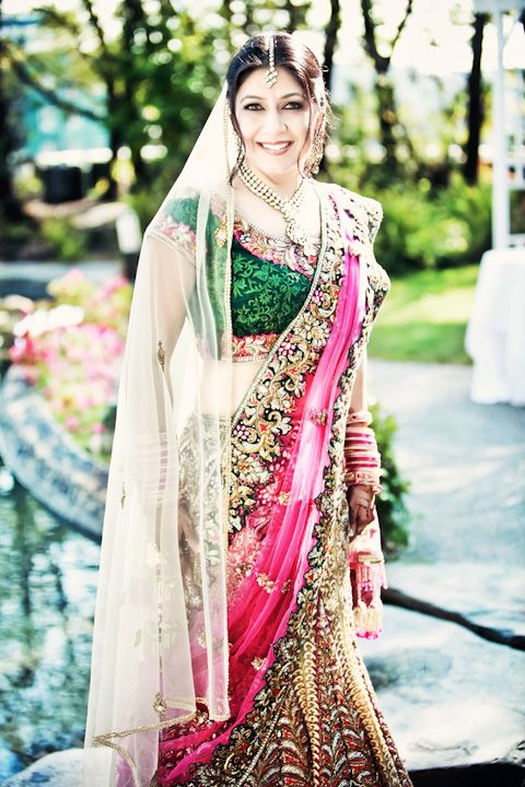 Indian Bride ## Elaborate design of the lehnga coupled with the flowing gold dupatta and minimalist kundan jewelry.love it
