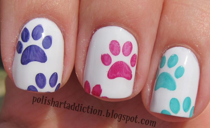 paws- adorable!!!  I'm thinking cut out a pencil eraser into the shape of the bottom part of the paw and use it to dip and dot onto the nail.