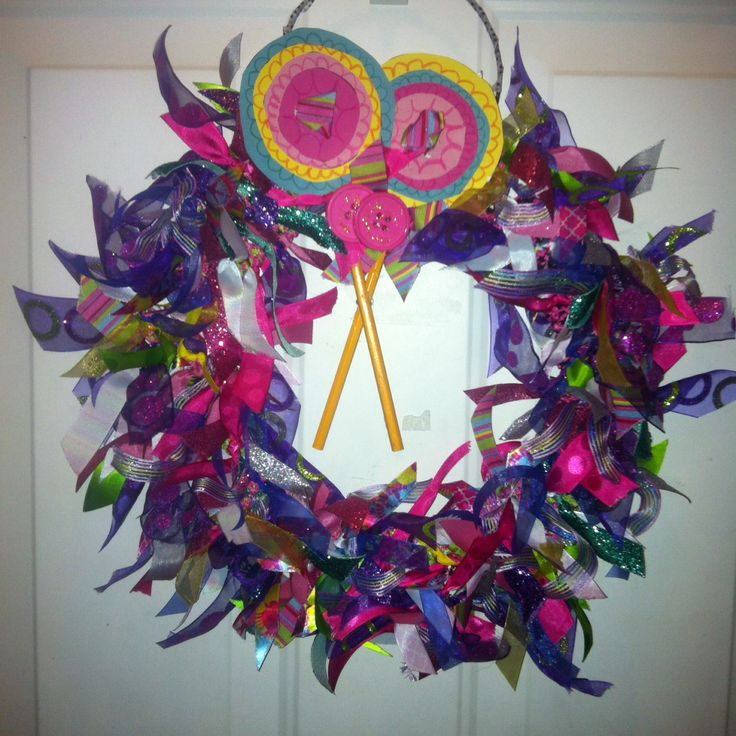 Me and my 9 year olds first attempt at a wreath. This one is for our Christmas theme Candy Land. All hand made even the form used ribbon I had so cost was probably about $1.00. My nine year old brilliant baby made the lollipops completely by herself!