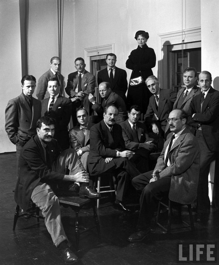 """Group portrait of American Abstract Expressionists, """"The Irascibles."""" From left, rear: Willem de Kooning, Adolph Gottleib, Ad Reinhardt, Hedda Sterne;(next row) Richard Pousette-Dart, William Baziotes, Jimmy Ernst (w. bow tie), Jackson Pollock (in striped jacket), James Brooks, Clyfford Still (leaning on knee), Robert Motherwell, Bradley Walker Tomlin; (in foreground) Theodoros Stamos (on bench), Barnett Newman (on stool), Mark Rothko (with glasses), NY, NY, ca. 1950."""