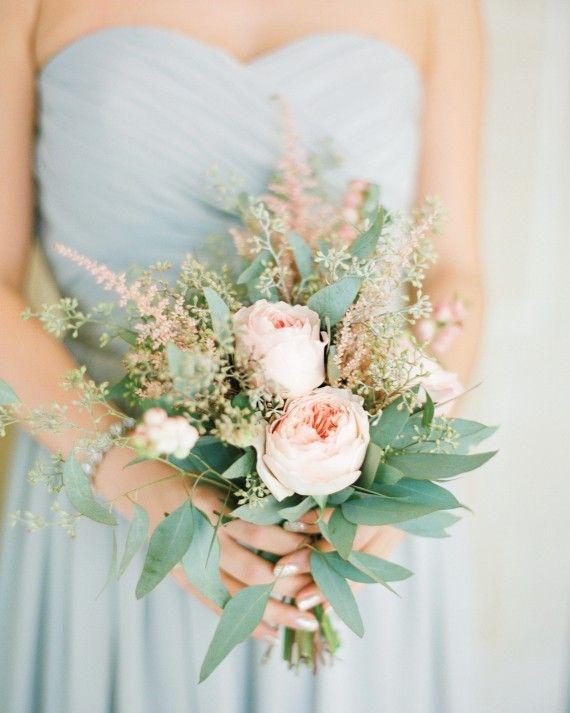 Bridesmaids held nosegays of garden roses, eucalyptus, and astilbes.