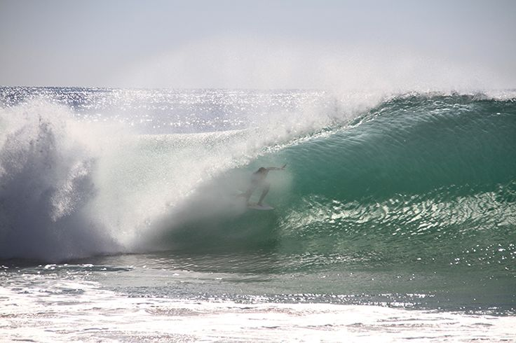 A surfer riding Peniche's famous 'supertubos' wave. - Lonely Planet/Francisco Caravana/iStock/Getty Images