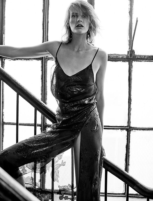 Photographed in black and white, Sara models a metallic slip dress designed by Hedi Slimane for Saint Laurent