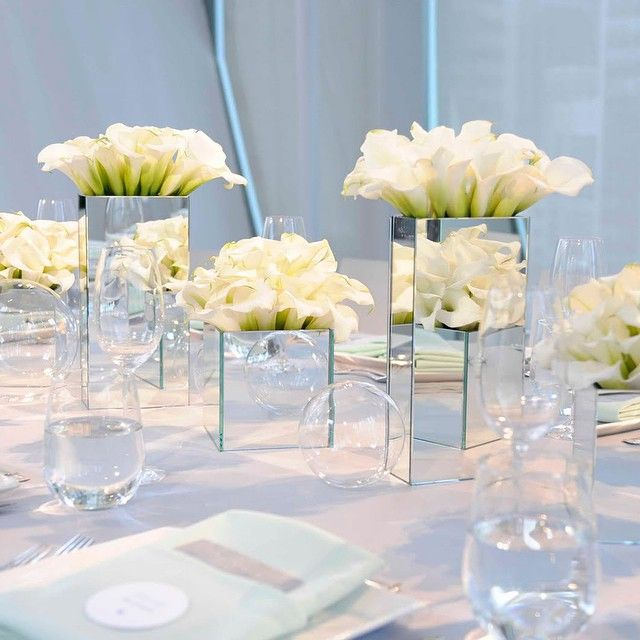 The architectural shape and pure color make calla lillies well suited for a…