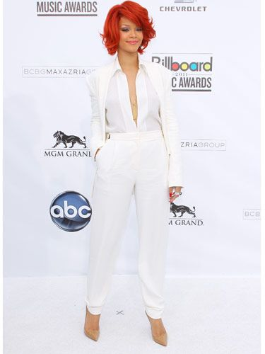 Rihanna wears white better than just about anyone else—case in point this super-hot pantsuit. To pull off an all-white look, go for a pair of nude or metallic shoes—you want a neutral that doesn't detract from the white.  Getty Images -Cosmopolitan.com