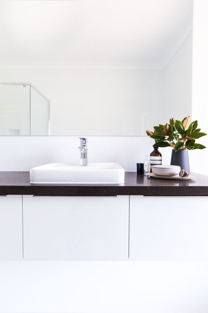 The wall hung vanity with drawers keeps this bathroom feeling nice and open. The large window also maximises the use of light, like the remainder of the house, keeping it light, bright and contemporary. - Shepperd Building Company