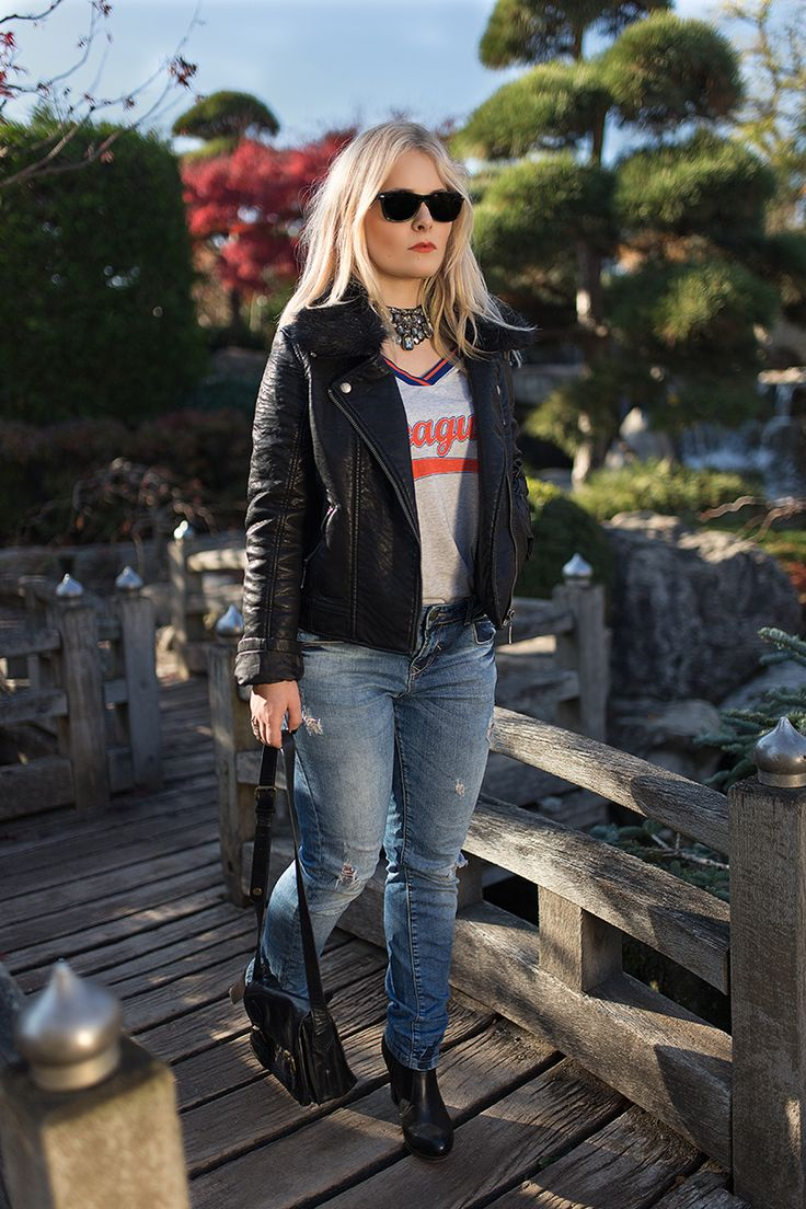 Christina Key is wearing a perfect outfit for fall with a light blue jeans and a leather jacket