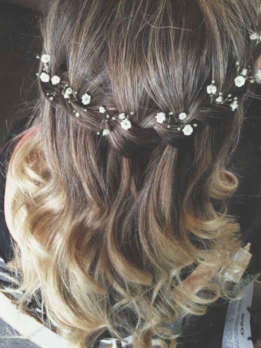 Delicate sprigs of gypsophila tucked into a loose waterfall braid // The Natural Wedding Company