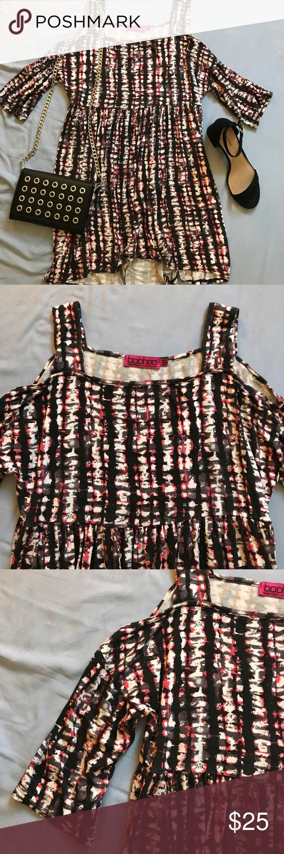 "Trendy cold shoulder dress This dress is so cute! It has thick straps with a cold shoulder details and flowy mid length sleeves. It is ""high-low"" so a little shorter in front, but not by much. It has an empire waist and falls beautifully to conceal any concern areas. The fabric is heavy enough that it is appropriate for going out in the evening or to wear to work during the day! It has a fun, hot pink, black, white, and grey design. Very versatile. Great condition. Will fit sizes 00-2…"
